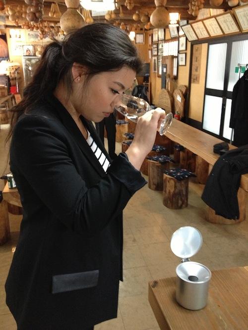 Miki tasting sake at Yoshinogawa sake brewery.